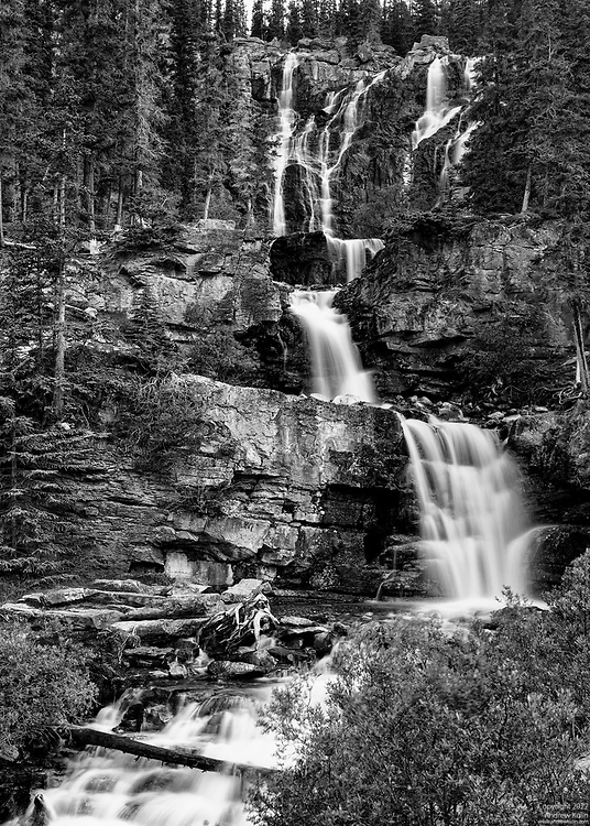 Tangle Falls is located right off of the Icefields Parkway in Jasper National Park, just north of the Athabaska Glacier.  I captured this image under less than ideal circumstances, around noon hour on a sunny summer's day.  I waited for at least half an hour for a cumulus cloud to finally block the sun so that I could photograph these falls in somewhat diffuse light.  A 10 stop ND filter was used to allow for a 2 second exposure so that the water would be blurred.
