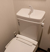 Wash hands atop toilets after flushing. Lodging in Kyoto, Japan.