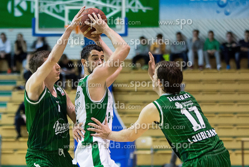 Stefan Sinovec #5 of Krka between Gregor Hrovat #7 of KK Union Olimpija Ljubljana and Sasa Zagorac #17 of KK Union Olimpija Ljubljana during basketball match between KK Krka and KK Union Olimpija Ljubljana in 5th Round of Nova KBM Champions League 2015/16, on April 13, 2016 in Sports hall Leon Stukel, Novo mesto, Slovenia. Photo by Vid Ponikvar / Sportida