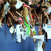 U.S. goalkeeper Hope Solo (1) signs autographs after  an international friendly soccer match between the United States Women's National soccer team and the Russia National soccer team at FAU Stadium on Saturday, February 8, in Boca Raton, Florida. (AP Photo/Alex Menendez)