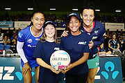 ANZ Future Captains Emma de Fleuriot aged 10 (L) and Talia Tataurangi aged 11 (R) with Maria Tutaia of the Mystics and Bianca Chatfield of the Vixens. 2015 ANZ Championship, Northern Mystics v Melbourne Vixens, The Trusts Arena, Auckland, New Zealand. 1 June 2015. Photo: Anthony Au-Yeung / www.photosport.co.nz