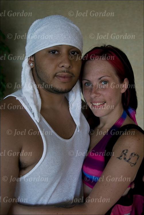 Portrait of young multi racial affectionate couple between 20-25 years, looking into the camera