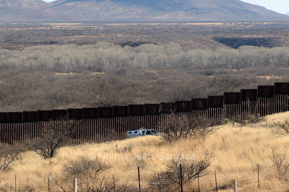 A U.S. Border Patrol agent patrols at the border wall near the San Pedro River in Palominas, Arizona, USA, across the border from Sonora, Mexico.