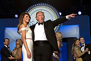 President Donald Trump and First Lady Melania Trump acknowledge the crowd as they dance during the Freedom Inaugural Ball.
