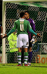 Yeovil Town's Reuben Reid squares up with Wycombe Wanderers' Jordan Archer  - Photo mandatory by-line: Dougie Allward/JMP  - Tel: Mobile:07966 386802 04/12/2012 - SPORT - FOOTBALL - Johnstone's Paint Trophy  -  Yeovil  -  Huish Park  -  Yeovil Town V Wycombe Wanderers