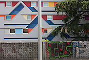 Hotel architecture and local graffiti at the De Guesclin tram stop in Montpellier, south of France.