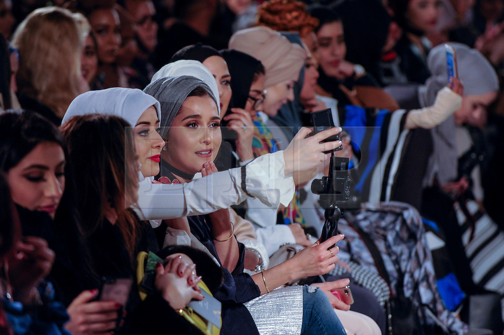 © Licensed to London News Pictures. 18/02/2017. London, UK.   Members of the audience await the first catwalk of the day at the UK's first London Modest Fashion Week taking place this weekend at the Saatchi Gallery.  The two day event sees 40 brands from across the world come together to showcase their collections for Muslim and other religious women. Photo credit : Stephen Chung/LNP