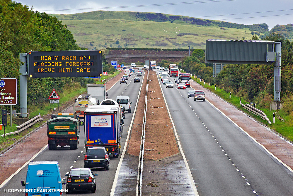 Busy motorway with gantry warning sign - M90 in Fife, Scotland near Forth road bridge.