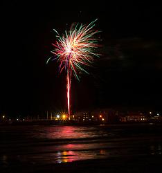 North Berwick, East Lothian, Scotland, United Kingdom, 05 November 2019. Guy Fawkes bonfire night fireworks light up the cold dark sky on a windy evening on the coast of the Firth of Forth. The fireworks are organised by East Lothian Yacht Club.<br /> Sally Anderson | EdinburghElitemedia.co.uk