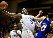 (1/4/10) - (Harrisonburg).James Madison's Denzel Bowles reaches for a loose ball during first-quarter action against Delaware at the JMU Convo on Monday night..(Pete Marovich/Daily News-Record).