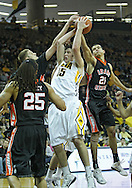 December 04 2010: Iowa Hawkeyes forward Zach McCabe (15) battles for a rebound against Idaho State Bengals center Deividas Busma (33) and forward/center Abner Moreira (21) during the second half of their NCAA basketball game at Carver-Hawkeye Arena in Iowa City, Iowa on December 4, 2010. Iowa won 70-53.