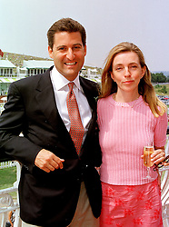 MR NICHOLAS RITBLAT son of top property developer John Ritblat and MISS REBECCA WILLIS, at a race meeting in West Sussex on 30th July 1999.MUP 41