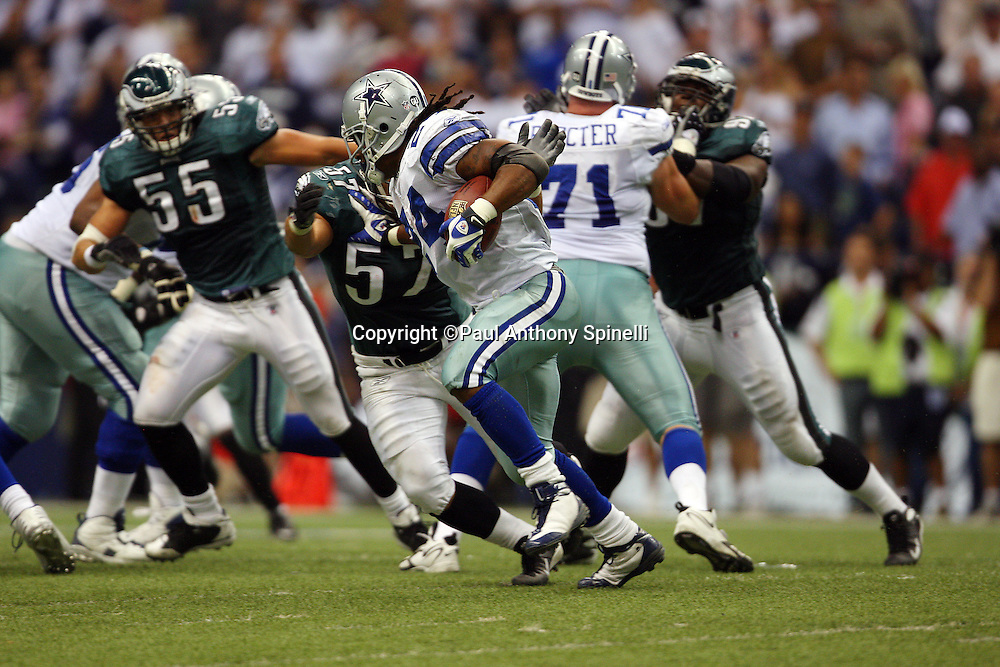 IRVING, TX - SEPTEMBER 15:  Running back Marion Barber of the Dallas Cowboys runs the ball during the game against the Philadelphia Eagles at Texas Stadium on September 15, 2008 in Irving, Texas. The Cowboys defeated the Eagles 41-37. ©Paul Anthony Spinelli *** Local Caption *** Marion Barber