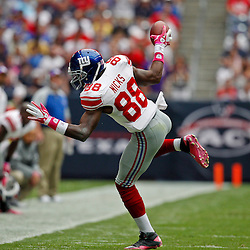 October 10, 2010; Houston, TX USA; New York Giants wide receiver Hakeem Nicks (88) catches a pass during the first half against the Houston Texans at Reliant Stadium. Mandatory Credit: Derick E. Hingle