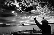 A supply helicopter takes off from the MV Pharos with supplies for the lighthouse on the uninhabited island of Hyskeir, eight miles from Rum in the Inner Hebrides on Scotland's west coast. The helicopter was delivering supplies to workmen who were converting the lighthouse from manned to automatic. The lighthouse was operated by the Northern Lighthouse Board and was one of the last in Scotland to be automated.