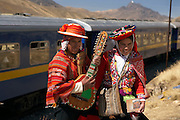 Entertainers pose at train stop on the train from Cuzco to Puno  Peru