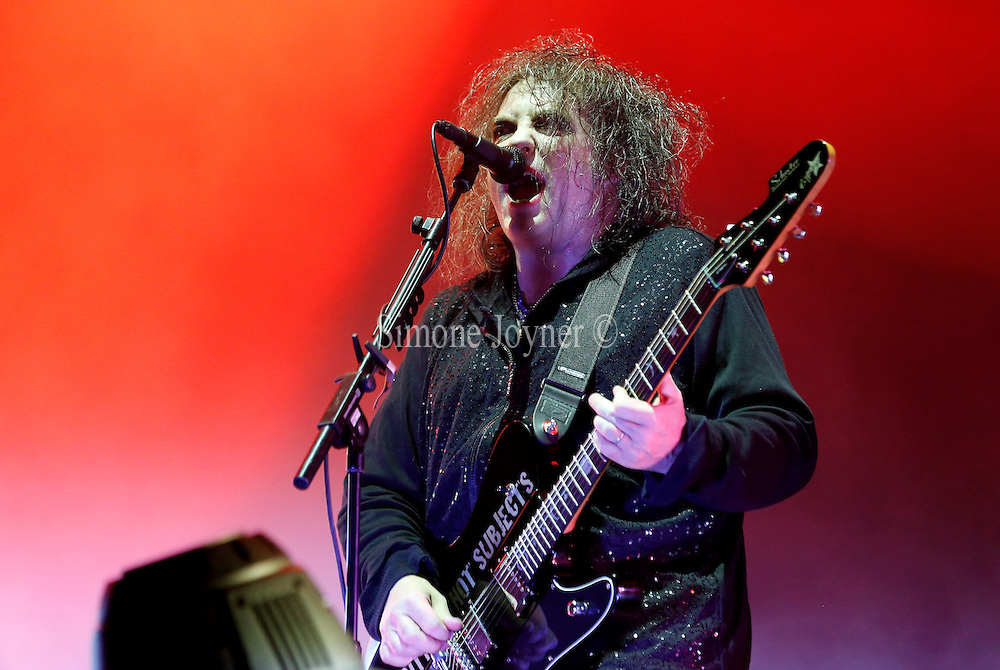 READING, ENGLAND - AUGUST 24:  Robert Smith of The Cure performs live on the Main Stage during Day One of Reading Festival 2012 at Richfield Avenue on August 24, 2012 in Reading, England.  (Photo by Simone Joyner/Getty Images)