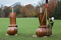 © Licensed to London News Pictures. 24/11/2016. Wakefield, UK. A legs of a giant sculpture by the artists KAWS are removed by sculpture technicians at the Yorkshire Sculpture Park in Wakefield, West Yorkshire. The American artist has had a collection of his sculptures at the park since early this year. Photo credit : Ian Hinchliffe/LNP