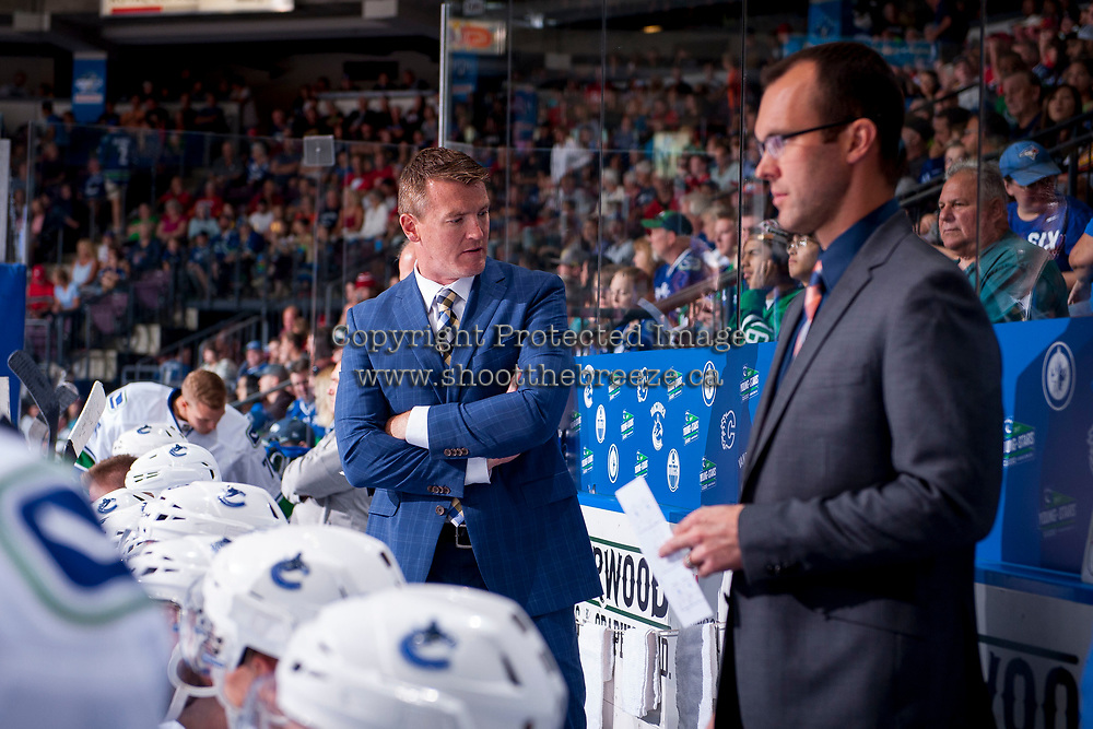 PENTICTON, CANADA - SEPTEMBER 10: Head coach Trent Cull of Vancouver Canucks stands on the bench against the Calgary Flames on September 10, 2017 at the South Okanagan Event Centre in Penticton, British Columbia, Canada.  (Photo by Marissa Baecker/Shoot the Breeze)  *** Local Caption ***