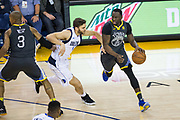 Golden State Warriors forward Draymond Green (23) handles the ball against the Dallas Mavericks at Oracle Arena in Oakland, California, on February 8, 2018. (Stan Olszewski/Special to S.F. Examiner)