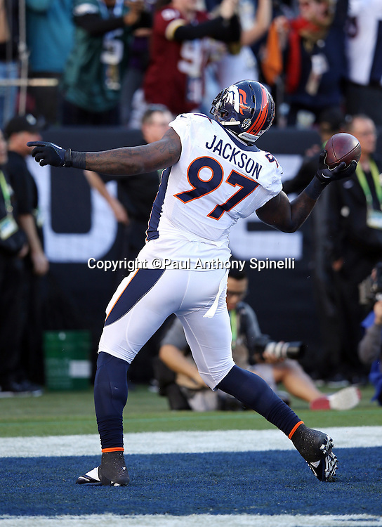 Denver Broncos defensive end Malik Jackson (97) throws the ball into the stands as he celebrates after recovering a fumble by Carolina Panthers quarterback Cam Newton (1) on a strip sack by Denver Broncos outside linebacker Von Miller (58) that gives the Broncos a 10-0 lead during the NFL Super Bowl 50 football game against the Carolina Panthers on Sunday, Feb. 7, 2016 in Santa Clara, Calif. The Broncos won the game 24-10. (©Paul Anthony Spinelli)