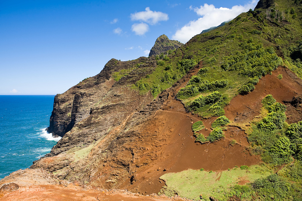 Erosion caused by voracious feral goats and rainy wearther patterns take a toll on the fragile landscape of the Kalalau Trail on the Na Pali coast of the north shore of Kauai, Hawaii.