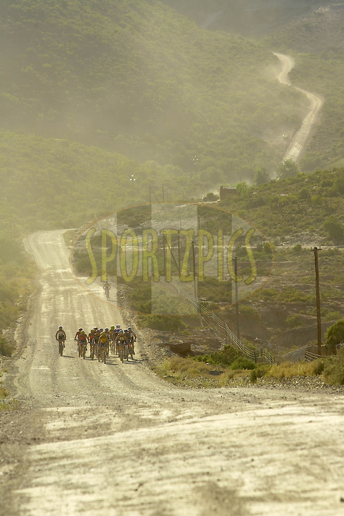 WESTERN CAPE, SOUTH AFRICA -  31 March 2008, the lead bunch enter the Klein Karoo during stage three of the 2008 Absa Cape Epic Mountain Bike stage race from Calitzdorp Spa..to Langenhoven High School in Riversdale, Western Cape, South Africa...Photo by Gary Perkin/SPORTZPICS