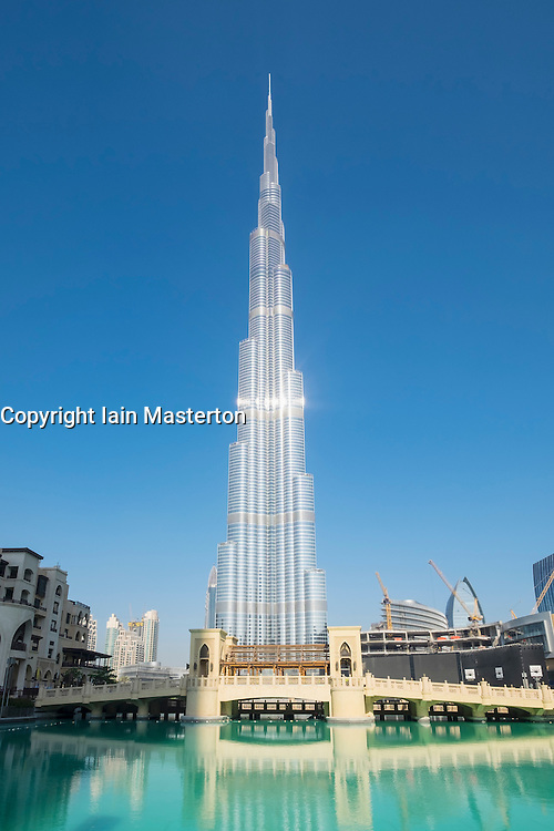 View of Burj Khalifa skyscraper , world's tallest building and lake at Dubai Mall  in Dubai United Arab Emirates