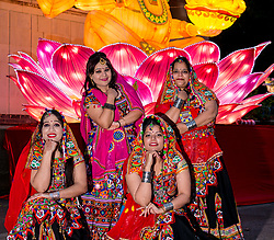 Ross Bandstand, Princes Street Garden, Edinburgh, Scotland, United Kingdom, 23 October 2019. Diwali Festival of Lights: Diwali Festival of Lights: Switch on of illuminations for Edinburgh Diwali with festive Indian dancers. The festival includes a number of events between October 23rd-26th. The festival culminates with a parade through the city on Saturday. Pictured: Edinburgh Dandiya performers.<br /> Sally Anderson   EdinburghElitemedia.co.uk