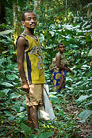 Sisko, an Mbuti tribe pygmy, with his wife, in the Okapi Wildlife Reserve of the Ituri Rainforest. The reserve is inhabited by close to 20,000 people, mostly Bantu origin agriculturalists, yet is also the home to thousands of semi-nomadic hunter-gatherer Mbuti and Efe pygmy tribes.
