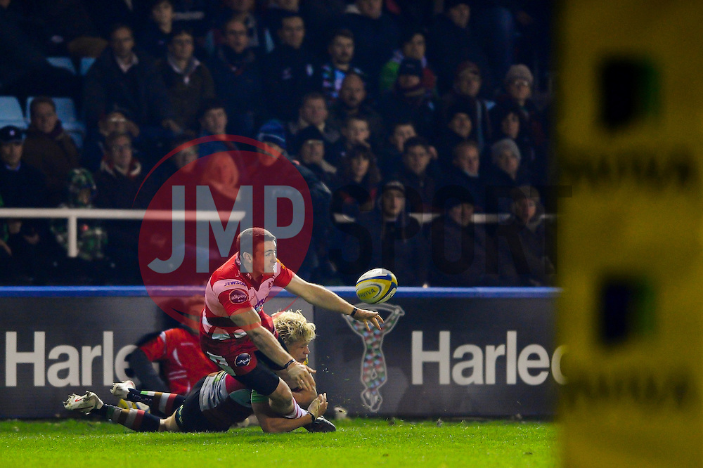 Gloucester Winger (#14) Shane Monahan offloads in the tackle during the second half of the match - Photo mandatory by-line: Rogan Thomson/JMP - Tel: Mobile: 07966 386802 03/11/2012 - SPORT - RUGBY - Twickenham Stoop - London. Harlequins v Gloucester - Aviva Premiership
