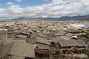 5 November 2006 - Shangarila, Yunnan - The rooftops of Shangrila old town with the modern buildings of the new part of town in the distance. Photo credit: Luke Duggleby