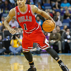 February 12, 2011; New Orleans, LA, USA; Chicago Bulls point guard Derrick Rose (1) against the New Orleans Hornets during the fourth quarter at the New Orleans Arena.  The Bulls defeated the Hornets 97-88. Mandatory Credit: Derick E. Hingle
