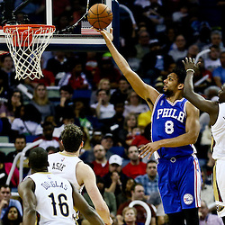 Feb 19, 2016; New Orleans, LA, USA; Philadelphia 76ers center Jahlil Okafor (8) shoots over New Orleans Pelicans guard Jrue Holiday (11) during the second half of a game at the Smoothie King Center. The Pelicans defeated the 76ers 121-114. Mandatory Credit: Derick E. Hingle-USA TODAY Sports
