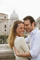 Couple hugging on bridge in Rom Italy side view