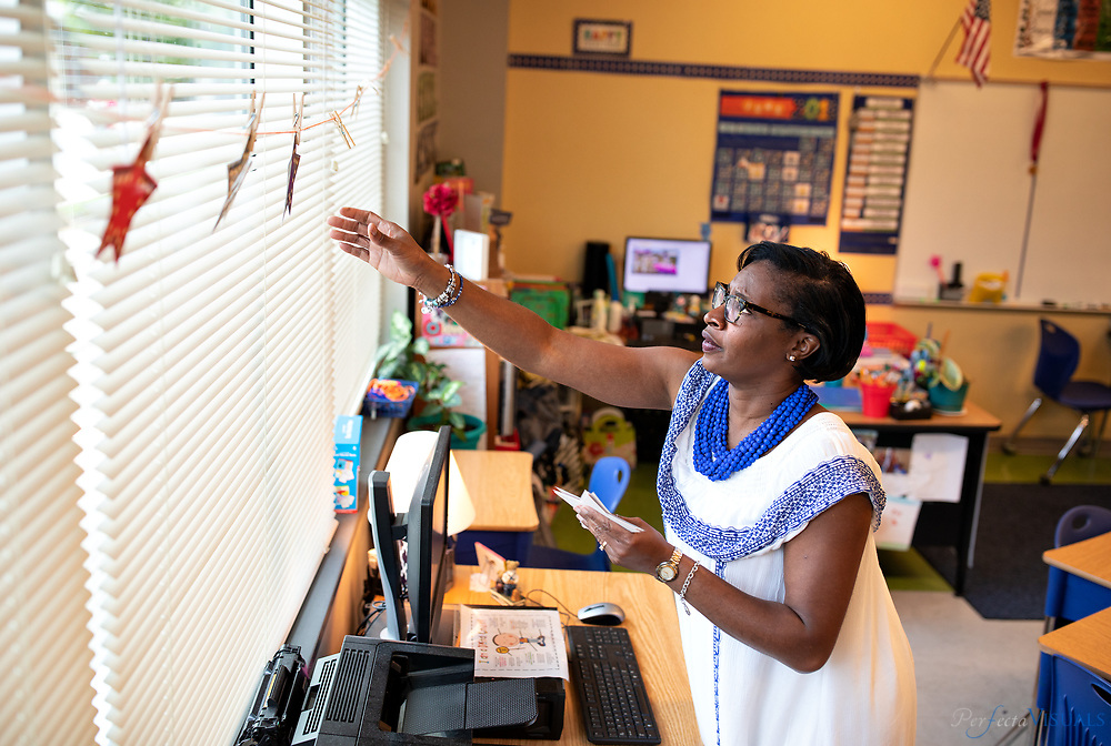 Last day of school at Ronald E. McNair Elementary School<br /> <br /> Regina Freeland removes decorations from her classroom.<br /> <br /> Photographed, Tuesday, June 12, 2018, in Greensboro, N.C. JERRY WOLFORD and SCOTT MUTHERSBAUGH / Perfecta Visuals