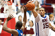 Cannen Cunningham #15 of the SMU Mustangs blocks the shot of Adonis Thomas #4 of the Memphis Tigers at Moody Coliseum on Wednesday, February 6, 2013 in University Park, Texas. (Cooper Neill/The Dallas Morning News)