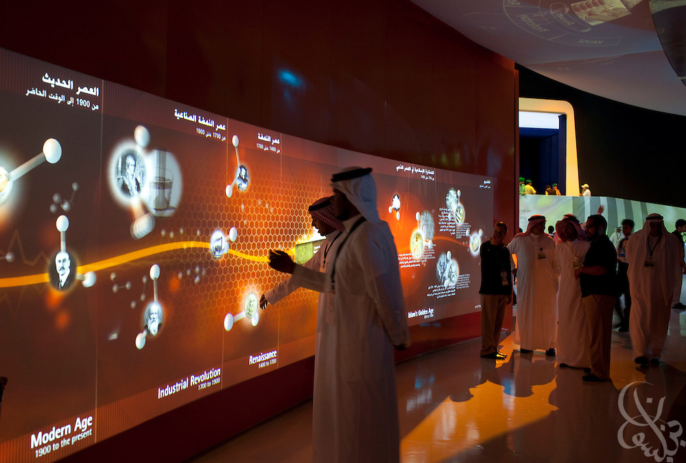 Saudi guests try out one of many interactive displays during the King Abdullah University of Science and Technology (KAUST) Inauguration Ceremony September 23, 2009 in Thuwal, Saudi Arabia (about 80 Kilometers north of Jeddah.) The University will act as a living laboratory by demonstrating that environmentally responsible methods of energy use, materials management, and water consumption are viable in the Middle East and across the globe. (Photo by Scott Nelson).