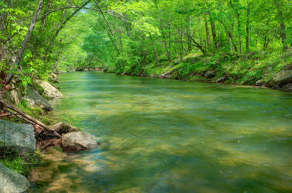 A gorgeous green spring afternoon on the Middle Saluda River was the perfect place for me to take my shoes off, get my feet wet and set up my tripod for this shot. After a bit of searching, I found this heavenly spot that was clear of the teeming fly fishermen. Very few places in North America are as beautiful as this part of South Carolina in the springtime!