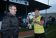 FC Menziehill captain Louis Clark receives the Trident Trophies league division 2 cup from DSMFA's Steve McSwiggan after his side had beaten Cairdy Thistle in the  final at Glenesk, Dundee, Photo: David Young<br /> <br />  - &copy; David Young - www.davidyoungphoto.co.uk - email: davidyoungphoto@gmail.com