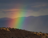 Segment of a rainbow formed over Otowi Mesa, with the Sangre de Cristo Mountains in the distance, © 2011 David A. Ponton