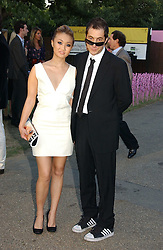BRUCE WILPON and his wife YUKI OSHIMA-WILPON at the Serpentine Gallery Summer party sponsored by Yves Saint Laurent held at the Serpentine Gallery, Kensington Gardens, London W2 on 11th July 2006.<br />