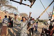 An operator pushes a man-powered ferris wheel in Kamrangirchar, Dhaka.