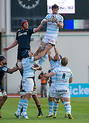 Highlanders player Joe Wheeler (L) challenges for the ball during the line-out with Racing 92 player Thibault Dubarry during the Natixis Cup rugby match between French team Racing 92 and New Zealand team Otago Highlanders at Sui San Wan Stadium in Hong Kong