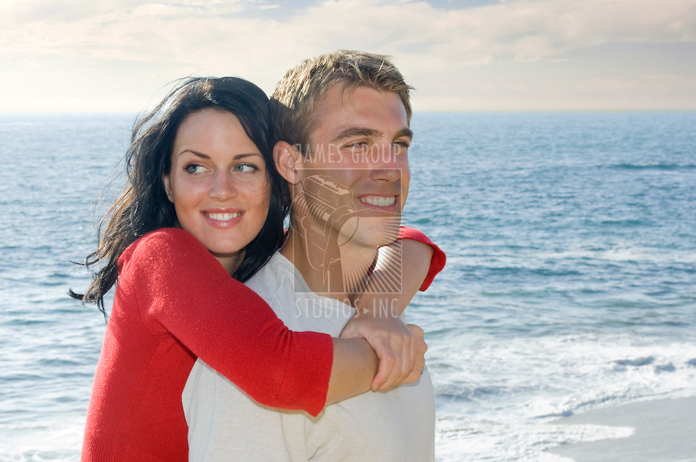 Young, attractive couple near the ocean