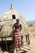 Africa, Ethiopia, Konso tribe man in front of his thatch roof hut