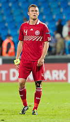 AALBORG, DENMARK - Saturday, June 11, 2011: Denmark's Andreas Bjelland (FC Nordsjaelland) looks dejected after his side's 1-0 defeat by Switzerland during the UEFA Under-21 Championship Denmark 2011 Group A match at the Aalborg Stadion. (Photo by Vegard Grott/Propaganda)