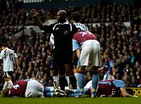 Photo: Ed Godden.<br /> Tottenham Hotspur v Aston Villa. The Barclays Premiership. 26/12/2006. Villa's Olof Mellberg and Aaron Hughes lie injured on the ground.