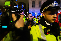 A right wing protester is led to a police van after being arrested as Remain and Leave supporters demonstrate as MPs debate Theresa May's Brexit deal in the House of Commons, across the road in London. London, January 15 2019.