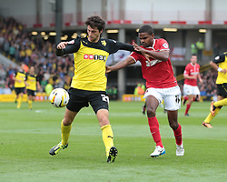 Watford's Ikechi Anya is challenged by Charlton Athletic's Bradley Pritchard  - Photo mandatory by-line: Nigel Pitts-Drake/JMP - Tel: Mobile: 07966 386802 14/09/2013 - SPORT - FOOTBALL -  Vicarage Road - Hertfordshire - Watford V Charlton Athletic - Sky Bet Championship